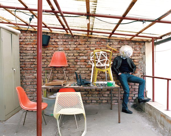 "The ""terrace"", in his unassuming former factory space not far from the main train station in Munich, is a place where he and his cohorts can step outside for a breath of fresh air. A handful of classics as well as his own chairs—–like the Myto (foreground) and the Chair One (on the table at right)—–upstage the suddenly bashful designer."