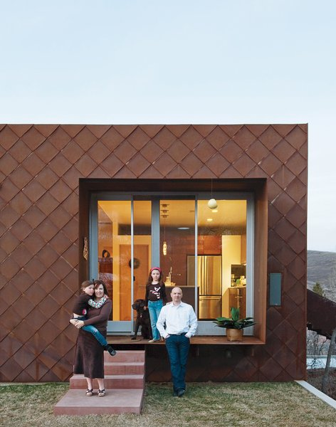 Anne and John pose outside their Cor-Ten steel-clad home with their daughters Claire and Audrey. Read the story about their house (Utah's for LEED for Homes-rated residence) here and check out their kitchen in Dwell's special 100 Kitchens We Love issue, on newsstands April 5, 2011.