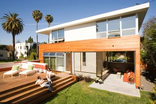 A large wood platform over the sunken garage serves as an outdoor gathering space.