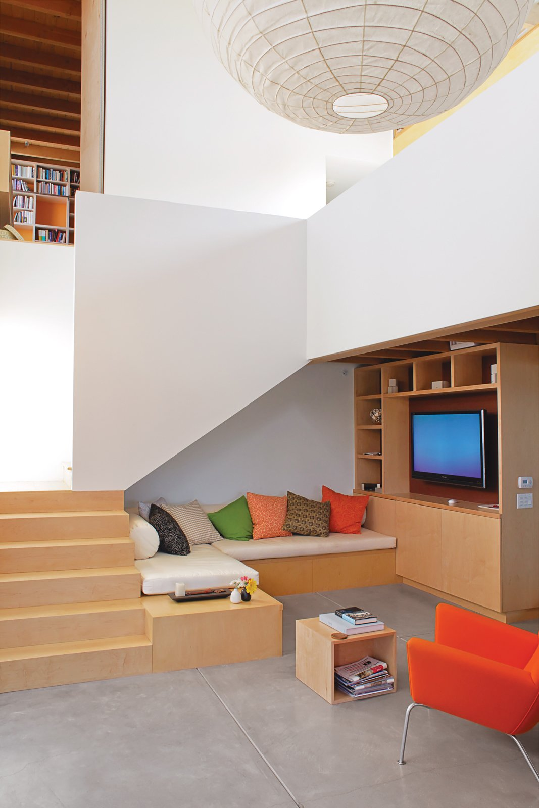 Built-ins reduce the need for furniture. Tagged: Ceiling Lighting, Accent Lighting, Concrete Floor, Storage Room, Wood Tread, and Shelves Storage Type.  Photo 1 of 13 in Coast Docs