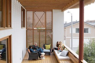 Cedar louvers increase privacy and shade on the second-floor deck, where Carole and Duane relax with granddaughters Natalie and Allison and their friend Katherine.