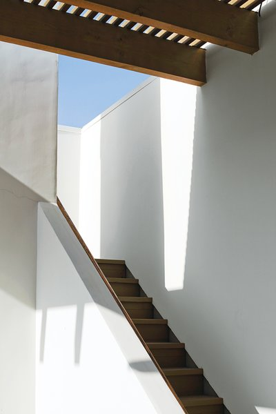 Sunlight and shadows accentuate the architectural forms around the stairway leading to the roof deck.