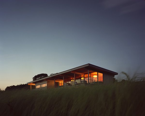 Architect and developer Cary Tamarkin designed and built his family's summer home to face due southwest to capture prevailing breezes all summer long. Courtesy Architects and Artisans. Photo  of Shelter Island Retreat modern home