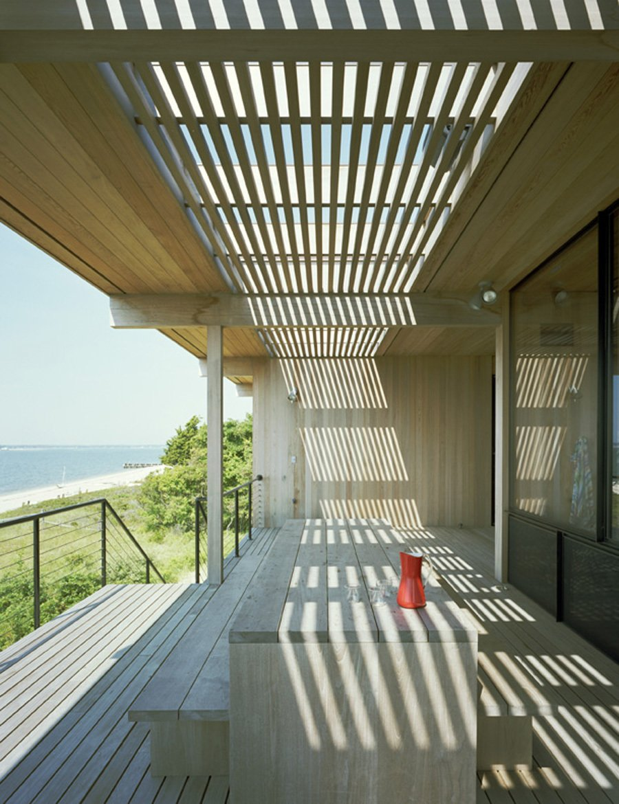 The exterior is clad in 100-year-old cypress meticulously crafted for the home by former shipbuilder George Velmachos of Wright and Company. Courtesy Architects and Artisans.  Shelter Island Retreat by J. Michael Welton