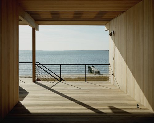 "Looking out to the water, the view peers back to Long Island with the Left Fork on its right, and the Right Fork just opposite. ""It's like a huge harbor with its outstretched arms around you,"" Tamarkin says. Courtesy Architects and Artisans. Photo 6 of Shelter Island Retreat modern home"