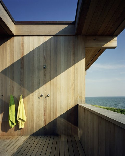 Reclaimed and recycled cypress beams measure 16 inches tall, six inches wide and are 36 feet long. Courtesy Architects and Artisans. Photo 12 of Shelter Island Retreat modern home
