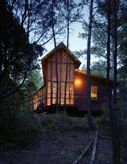 "101 Best Modern Cabins - Photo 67 of 101 - ""I wanted more of a skeletal look for this house, and less of a chunky, log-cabin look,"" says Panton, who added stark steel bracing across the entire length of the porch's roof structure."