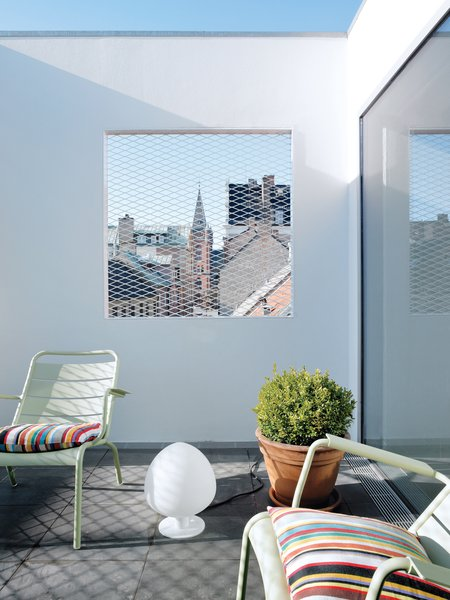 "The roof terrace offers a view of the town square, ""filtered"" through a grille."