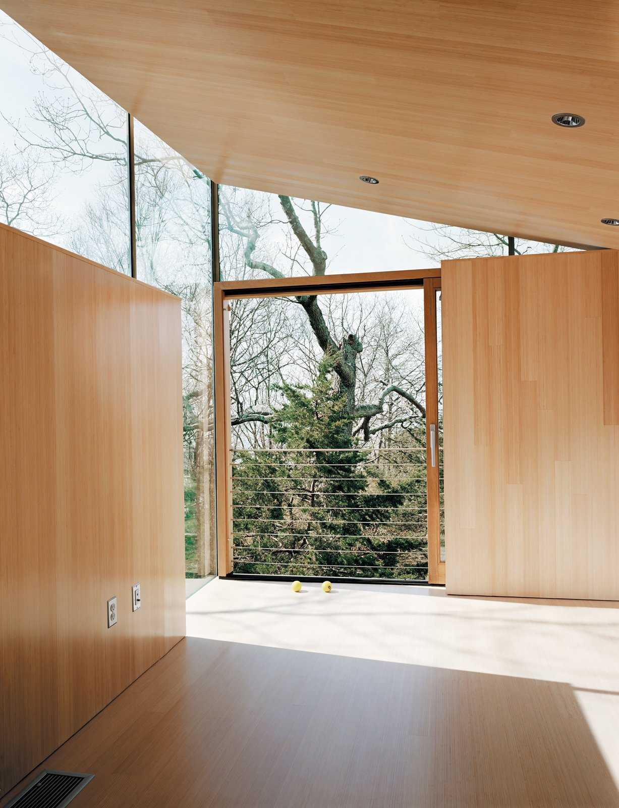 The bright, reflective surface amplifies natural light and bathes the interior in a warm glow even when the New England sun isn't cooperating. Striking Angular Cottage in Connecticut - Photo 9 of 10