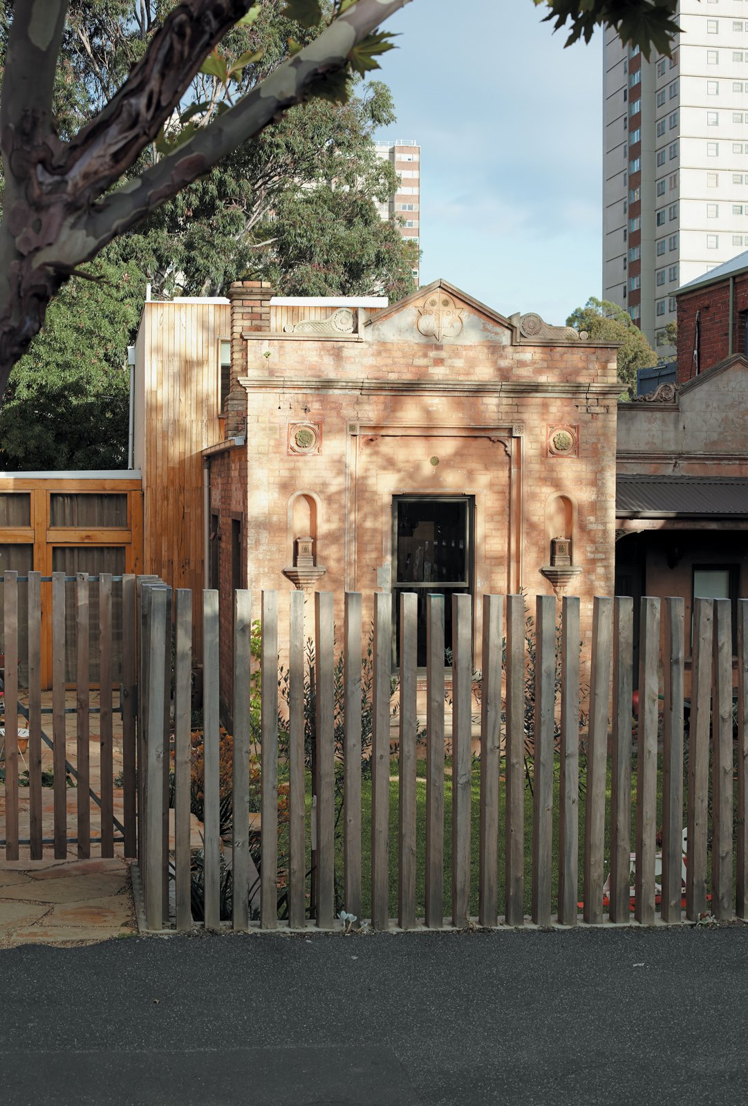 From the street, the most visible element of the George Street Residence is the original brick structure.  Photo 4 of 9 in 1860s Stable Modernized in Melbourne