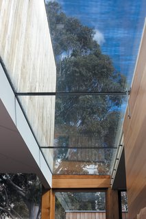 1860s Stable Modernized in Melbourne - Photo 6 of 9 - The skylight in the kitchen keeps things quite bright.