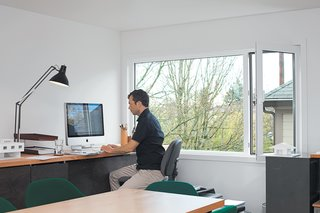 The home is conducive to both work and play–— Waechter attends to business in his home office.