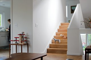 """To maintain the seamless connection from room to room, it was important that the flooring material was the same throughout the house,"" Waechter says. ""We took that continuity down to the smallest detail, eliminating the nosing so the treads look like a folded floor rather than a stair made up of treads and risers."""