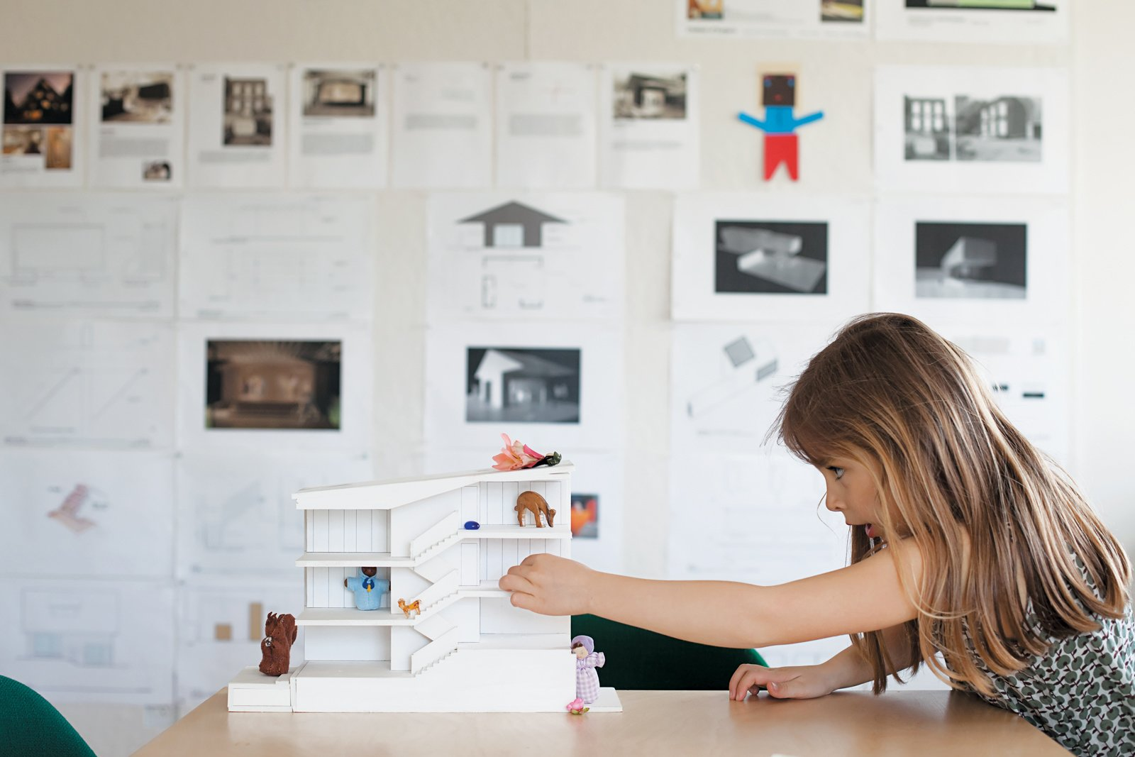 Zoë plays with a model in the office.  Office by Tiwat from Z for Two
