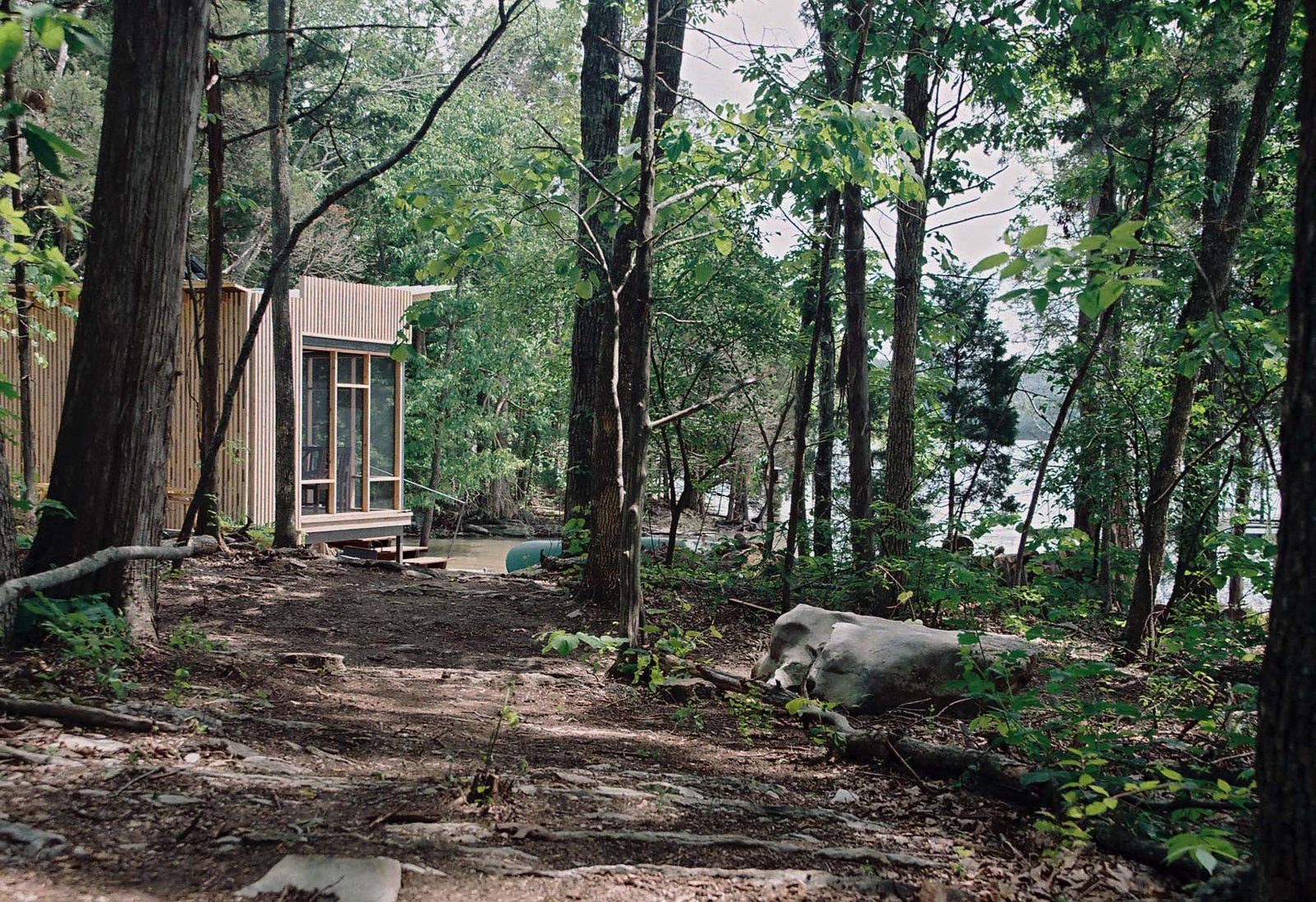 "Suzanne Shelton built a ""little cottage to get away to"" on Tennessee's Norris Lake that's equipped with both rainwater-harvesting and solar-power systems for off-the-grid living."