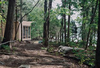 "How to Build an Off the Grid Cabin - Photo 3 of 4 - Suzanne Shelton built a ""little cottage to get away to"" on Tennessee's Norris Lake that's equipped with both rainwater-harvesting and solar-power systems for off-the-grid living."
