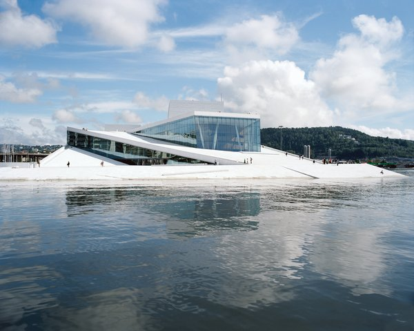 "The 400,000-square-foot Norwegian National Opera and Ballet, designed by the Oslo- and New York–based firm Snøhetta, features a plaza and roofscape conceived as a single glacierlike object entirely available to the public—–embracing what architect Tarald Lundevall calls the ""Scandinavian idea of common ownership."""
