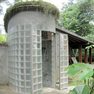 5 Light-Filled Spaces That Use Glass Blocks Creatively - Photo 3 of 5 - An outdoor shower in Costa Rica constructed by green homebuilder B-green Homes utilizes a mechanism for French doors from nearly two centuries ago that's sturdy enough to withstand the weight of glass block. The result is a unique shower with a grand entryway that lets natural light filter through.
