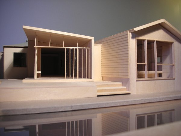 "Misra and Pande created a tiny wood three-dimensional model of the addition, showing the relationship between the separate elements. At far left is the existing kitchen, and the jog between the two portions of the addition represents a pause between the new spaces. ""We went thru a fair number of architectural models before we all decided upon this specific configuration,"" says Pande. Image courtesy Chinmaya + Apurva: Collaborative"