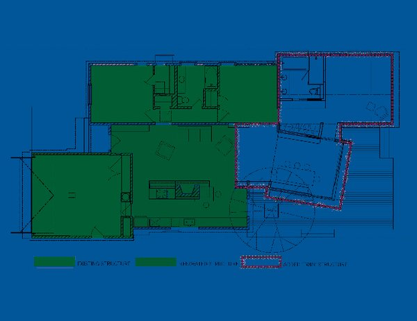 "The floor plan reveals the existing house, in green, and the addition, bordered in red. The angle of the lantern ""was a pretty intentional shift on our part,"" says Misra. ""First we had it parallel to the barn on plan, but we tweaked it a little and gave it an angle, because when standing on the patio and looking out to the pool, the sightline is best this way. In a parallel format, the patio and pool felt a little close, and this way we were able to maximize the spacious feeling by playing with the angles slightly."" Image courtesy Chinmaya + Apurva: Collaborative"