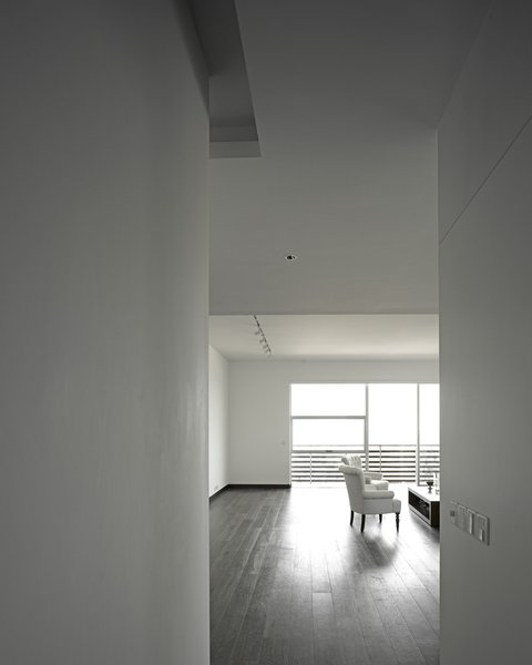 The owner's apartment, which incorporates a double-height space in some areas, has teak floors, whereas the other units have more industrial concrete floors.