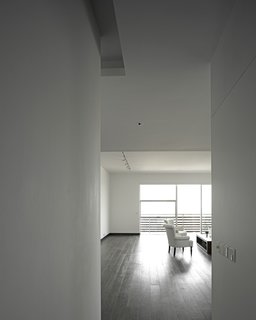 A Modern Aesthetic in Mumbai - Photo 15 of 17 - The owner's apartment, which incorporates a double-height space in some areas, has teak floors, whereas the other units have more industrial concrete floors.