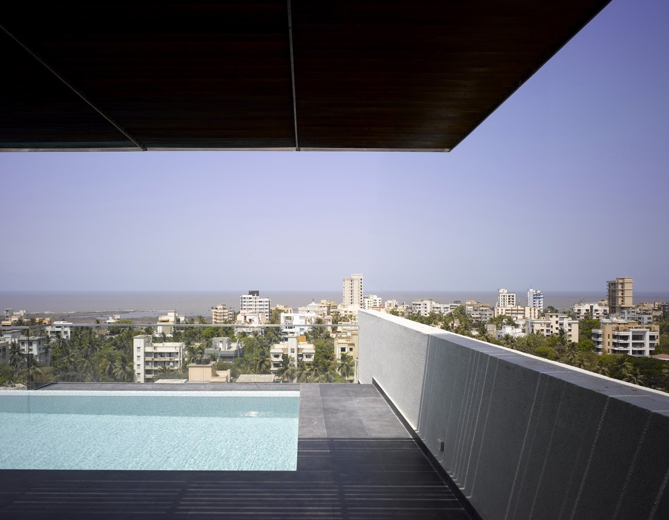 Khanna and Schultz introduced a deep, cantilevered overhang to the owner's terrace, which has a pool and a view of the city and the Arabian Sea.  Photo 16 of 17 in A Modern Aesthetic in Mumbai