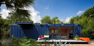 While shopping for containers, Hill was instantly drawn to this one's existing blue color and chose to buy it and leave it as is. Poteet added floor-to-ceiling sliding doors to allow light in, as well as a cantilevered overhang to shade a window on the left side, which houses a small garden storage area.