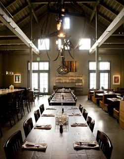 """13 Brilliant Barn Conversions That Merge Past and Present - Photo 11 of 13 - The location for a new restaurant, Farmstead, was a barn on the ranch that had been used as a plant nursery. """"It wasn't an incredibly old barn,"""" Johanson says. """"It was built around the 1970s, but it was built with a very agricultural look."""" To stay true to its form, EDG Interior Architecture and Design decided to leave as much of the structure intact as possible, playing up the post-and-beam system and revealing the shape of the roof on the interior."""