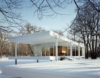 101 Best Modern Cabins - Photo 87 of 101 - Here's the cover image in all its glory. Van der Rohe's Farnsworth House is the essential glass house (sorry Philip J) and looks pretty spectacular in the snow. One wonders if those windows are double-paned though. Photo by Jason Schmidt.