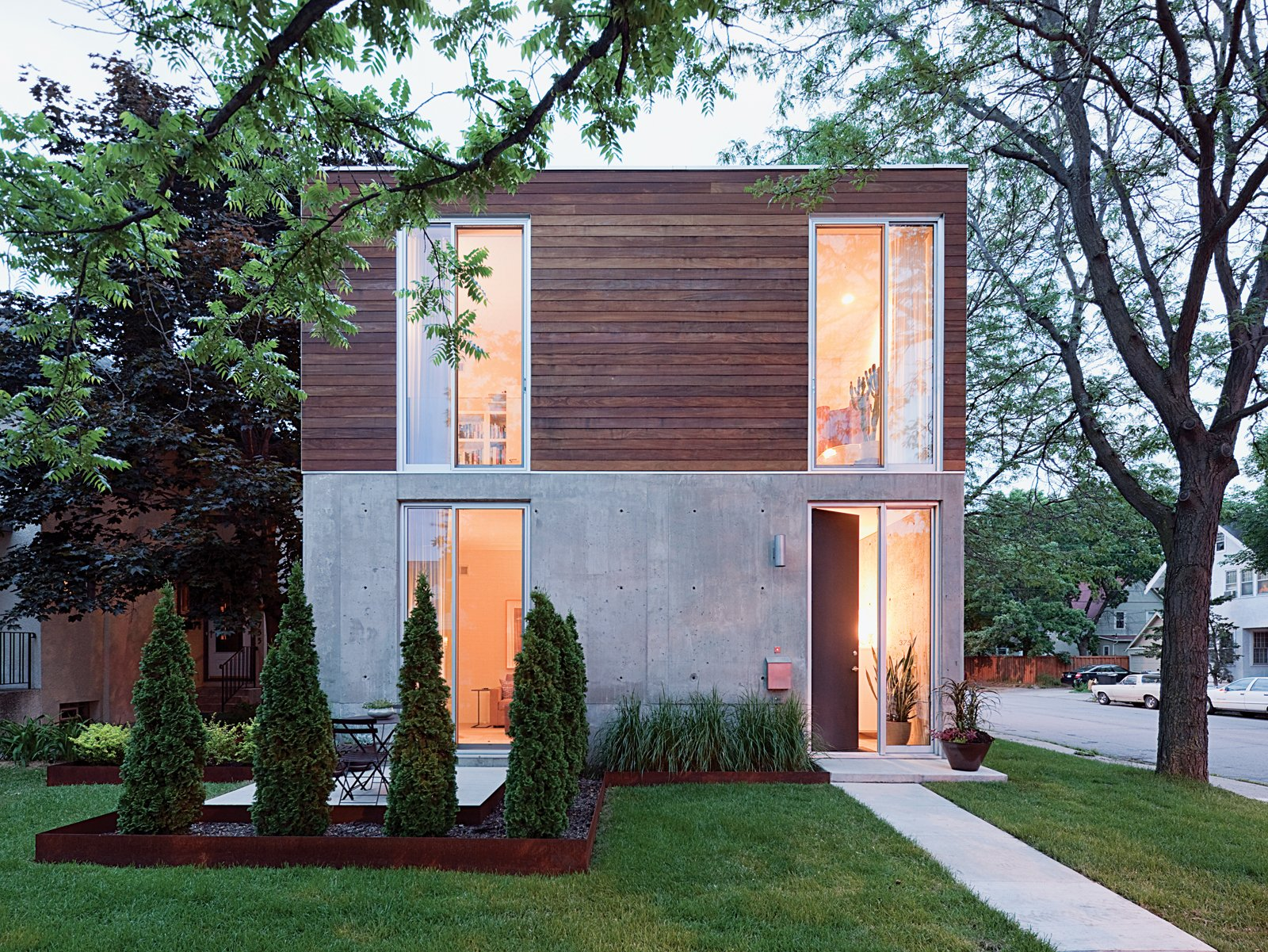 """I simply was drawn to the notion of concrete. So much great modern architecture has made use of it,"" Blauvelt says. Tagged: Exterior, Wood Siding Material, Concrete Siding Material, House, and Flat RoofLine.  Photo 17 of 21 in I Love Modern Architecture from Modern Urban Retreat in South Minneapolis"