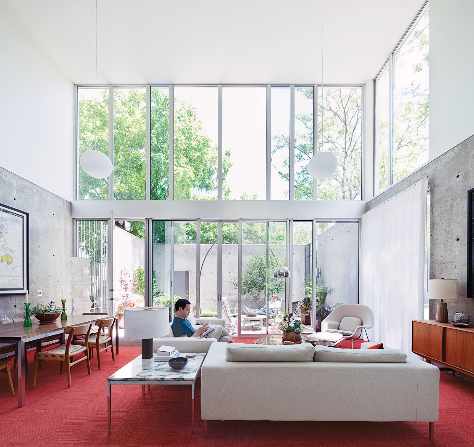 A loveseat and two Neo arm chairs by Niels Bendtsen in the living room offer Blauvelt a light-filled view to the courtyard beyond. Tagged: Living Room and Sofa.  Photo 6 of 29 in Modern Urban Retreat in South Minneapolis