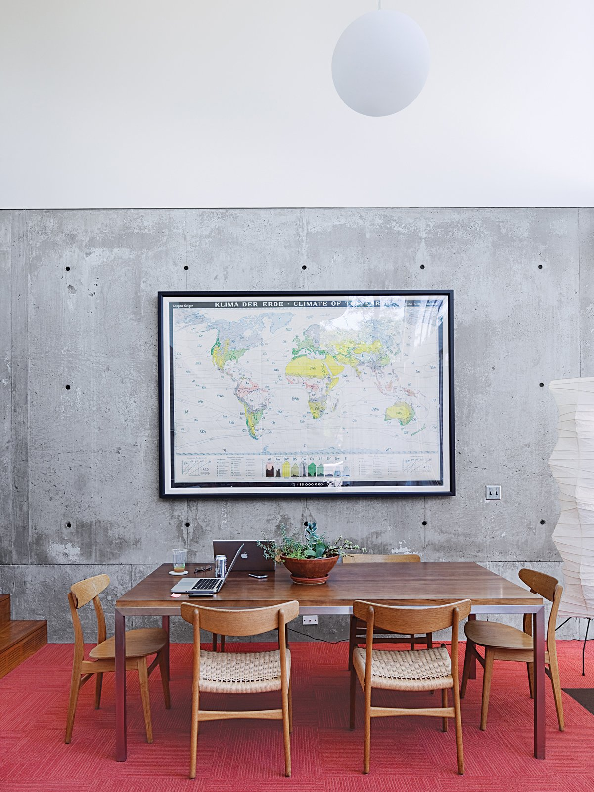 A monumental German climate map enlivens the dining area, which also sports CH 23 & CH 30 chairs by Hans Wegner.  In the Home by Carl Hansen & Son from Modern Urban Retreat in South Minneapolis