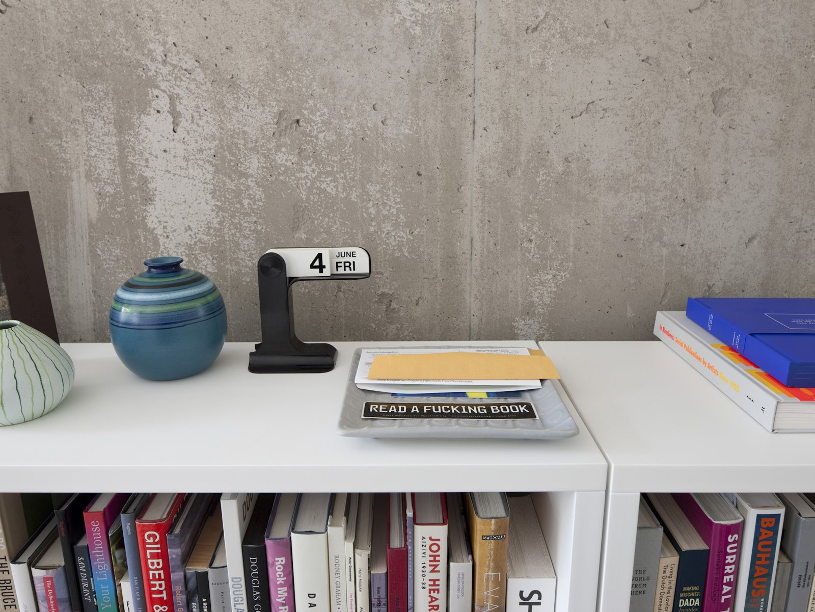Design tomes, a salient message, mid-century ceramic. Modern Urban Retreat in South Minneapolis - Photo 17 of 29