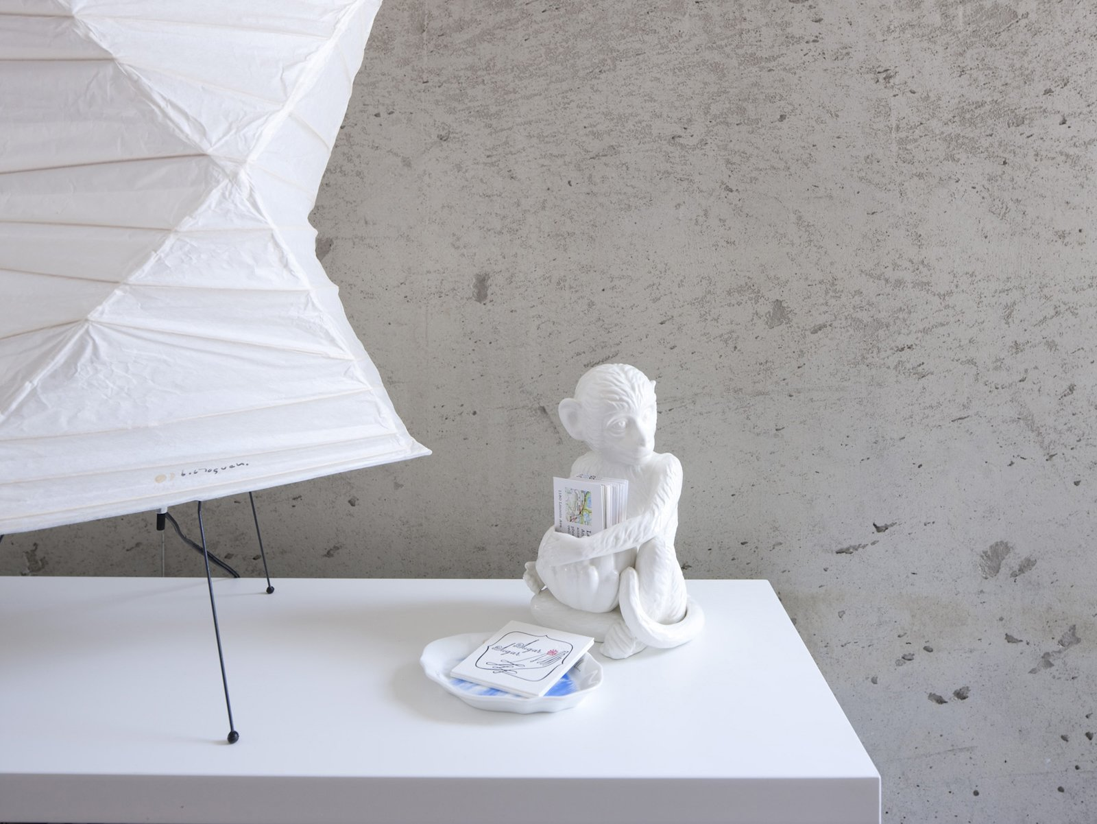 Noguchi lamp, meet the business-card-carrying ceramic monkey.