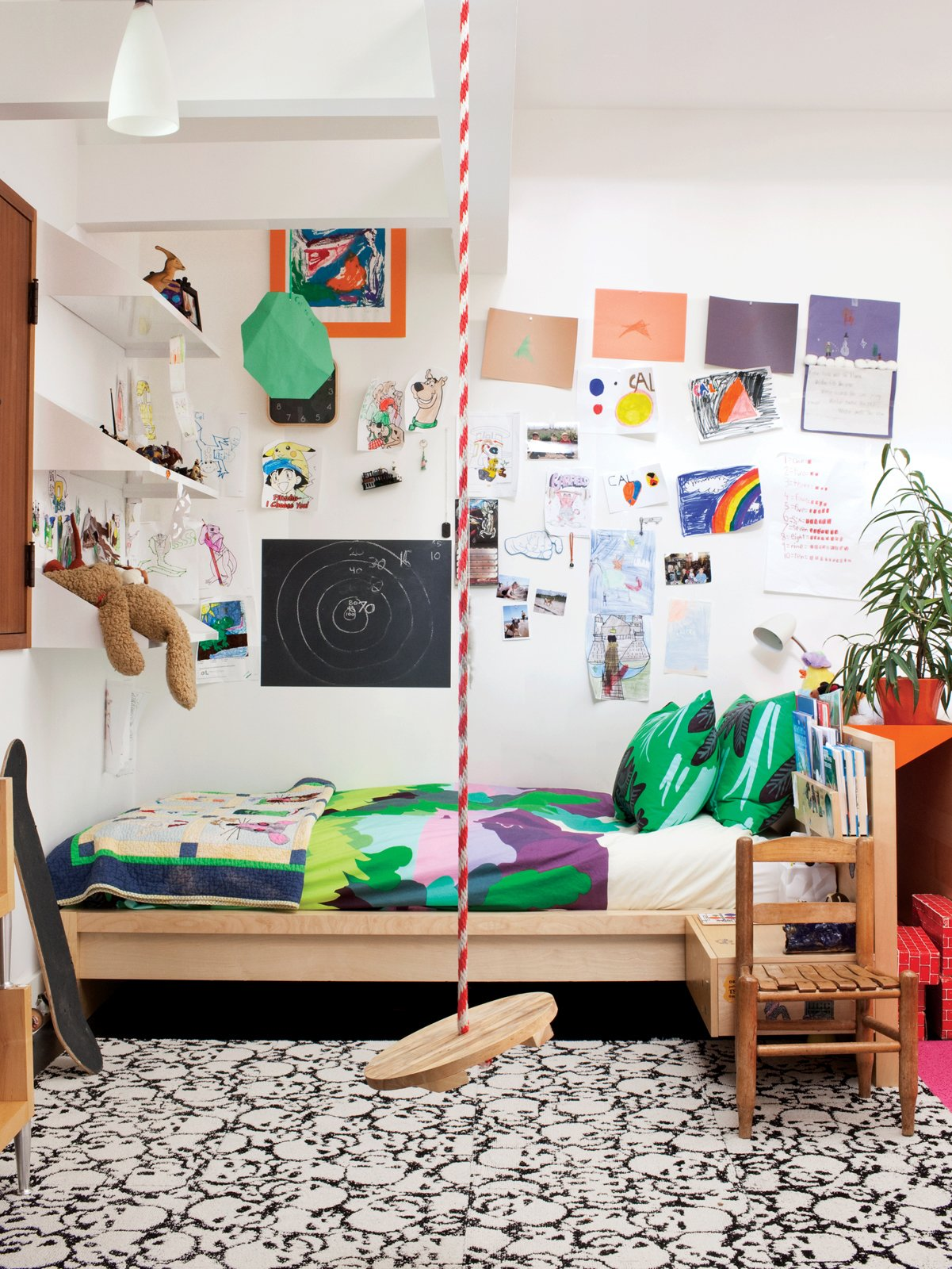 In addition to a swing, Cal's room features Maija & Kristina Isola's Sola bedding for Marimekko. Tagged: Kids Room, Bed, Bedroom, and Neutral Gender. 15 Modern and Creative Spaces For Kids - Photo 2 of 16