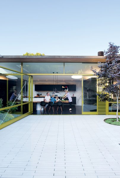 Unable to alter the footprint of the building, the Deams created a backyard living area that nearly doubled the home's living space.
