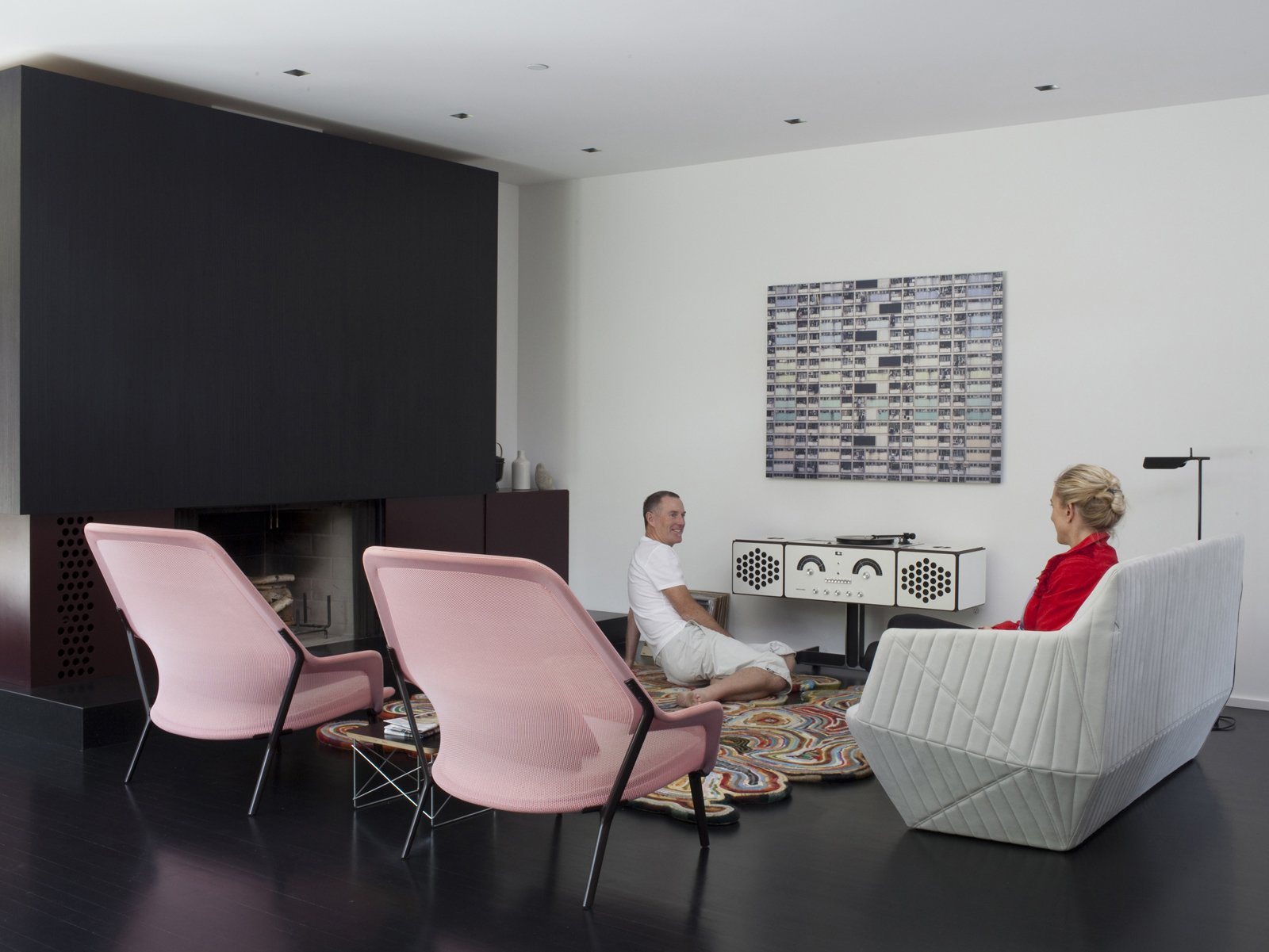 The living room is home to two Bouroullec Brothers designs: the Facett sofa for Ligne Roset, and the Slow chair for Vitra.  Photo 14 of 15 in How to Design with Pink from Designed In-House