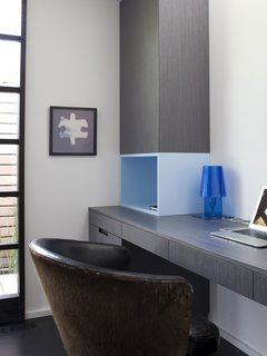 Lara's home office consists of a MacBook Air and Ferruccio Laviani Abat-Jour lamp for Kartell.