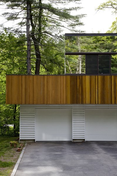 """The first floor was about making something warm and woody that would blend into the natural environment,"" architect Stephen Chung says of his Wayland, Massachusetts, home. ""The second floor was a chance to experiment."""