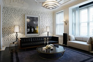 Autoban and their House Hotel - Photo 3 of 12 - For another residence in Turkey, the pair used brass and leather as luxurious counterpoints to whitewashed brick.