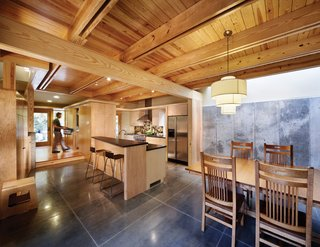 Triangle House Tours - Photo 9 of 30 - As an infill project in one of Raleigh's oldest downtown neighborhoods, the sustainable design features are unique--SIPs construction, geothermal heat pump, solar hot water for radiant heat and domestic use, rainwater collection, hardiplank siding, local pine trim, native landscaping and efficient space design.