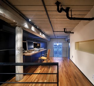 The addition of a loft increases square footage, providing a larger, more private office/workspace.