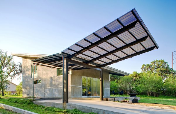 "After the home was completed, Wong asked for the carport addition. ""I handed Jay two books: one on Alexander Calder's mobiles, and one on insects,"" says Wong. The result was a soaring, winglike steel, aluminum and Galvalume structure fabricated by the architects that gives additional protection from the sun, provides a smoother transition from exterior to interior, and allows clients and other visitors a covered space under which to park."