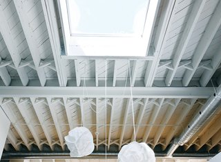 Skylights provide crucial natural light in the dining area and bedroom.