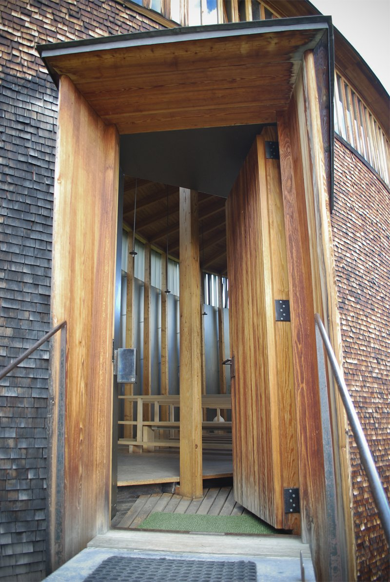 The door was an extremely interesting element, from the long vertical slats to the metal door handle that felt just right for the silent procession into the heart of the building.  A Pilgrimage to Zumthor's Chapel by Tiffany Chu