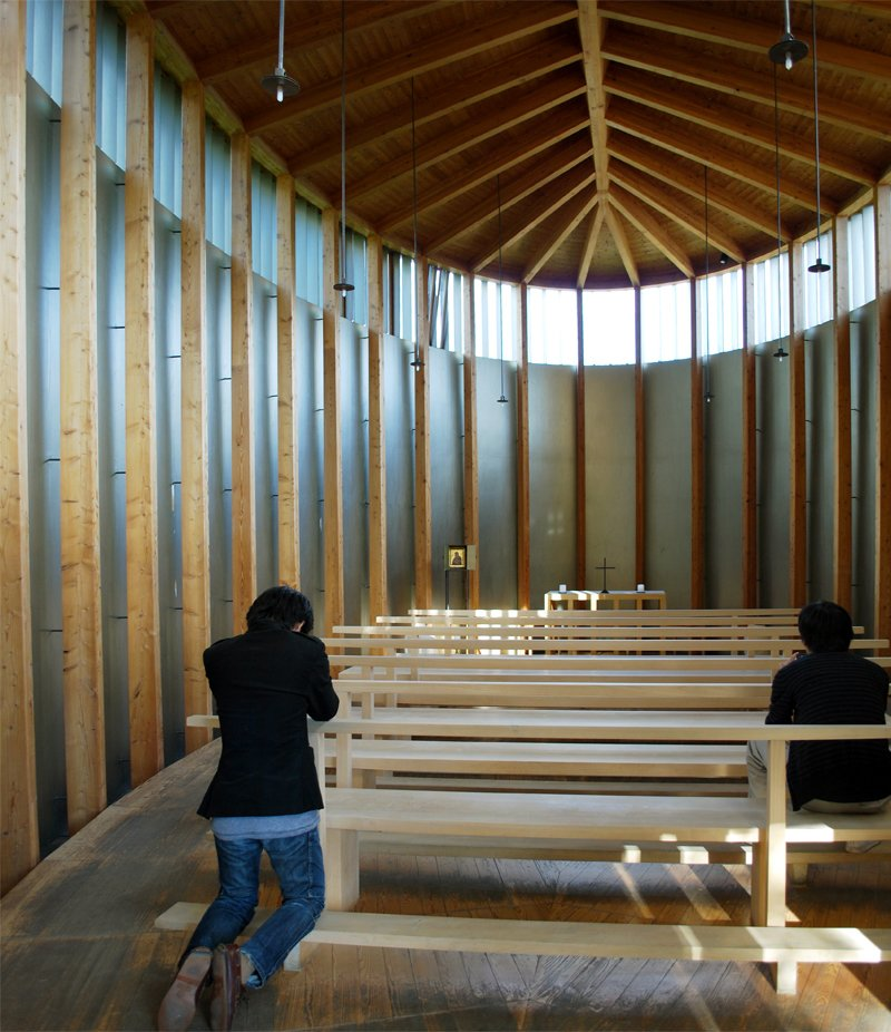 Its unconventional fish-like shape and signature wooden ceiling backbone with fins create a symmetrical, anchoring feeling while sitting in the pews.  A Pilgrimage to Zumthor's Chapel by Tiffany Chu
