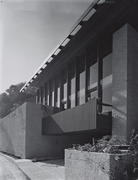 Having fallen into great disrepair and almost subjected to the wrecking ball until Shulman's original photographs were found on the property and used for a historically accurate renovation, Carl Louis Maston's 1962 Hillside House still survives. The home is surrounded by earth and set into a 45-degree slope. The sundeck above the driveway shields the master bedroom from the street. © J. Paul Getty Trust. Used with permission. Julius Shulman Photography Archive, Research Library at the Getty Research Institute (2004.R.10)