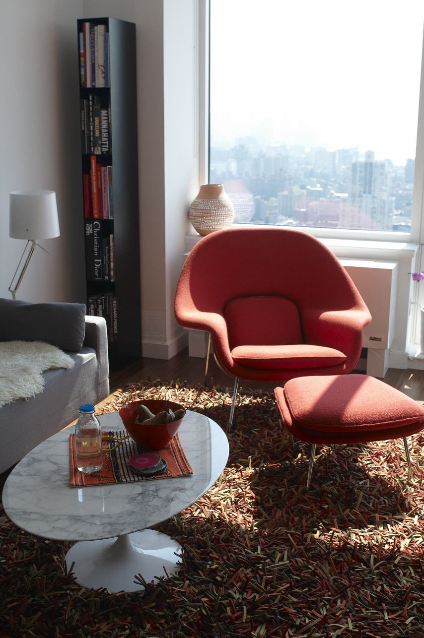A Hella Jongerius vase for Ikea, Saarinen chair and table, and a Nani Marquina rug fill this sunlit apartment.  Blu Dot Spotted by Blu Dot from An Afternoon with Michael Mundy