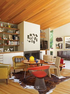 In the living room, local artwork and an elegant redwood ceiling watch over a side chair by Warren Platner for Knoll and an Easy Edges side chair by Frank Gehry for Vitra.